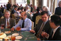 Steering Committee table at the WOM luncheon ( Left to right) Ken Budinski (Exhibits Chair), Steve Shaffer(Case Studies Editor), Jeff Hawk (Program Chair), Aiguo Wang (General Conference Chair)