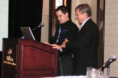 Peter Filip (right) introduces the next speaker, in the brakes session.
