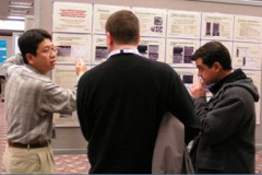 Jun Qu explains his poster