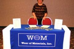 Evelyn Blau staffs the WOM, Inc. booth