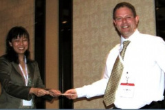 Christina Lim presents the best poster award.  Representing the winners was Mark Rainforth.