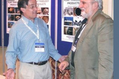 George Plint explains his equipment to a colleague
