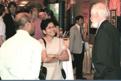 J. Bijwe talks with Dave Rigney at the poster session