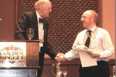 Dr. Phil Shipway of the University of Nottingham accepts the Ludema Best Paper Award on behalf of the authors