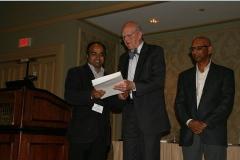 Mathew T. Mathew accepts the Ken Ludema Best Paper Award