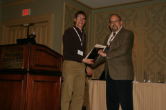 Tevis Jacobs accepts Best Poster Award from Peter Blau