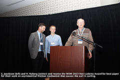 S. Jacobson (left) and H. Nyberg (center) and receive the WOM 2013 Ken Ludema Award for best paper for their work on asymmetrical friction mechanism that causes the curl in curling