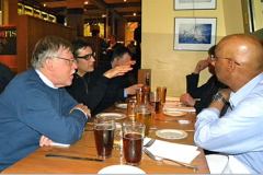 Marcello Papini gestures while Somuri Prasad, John Williams, Alfons Fischer and Cris Shwartz look on at the 2013 WOM Editorial Committee Dinner